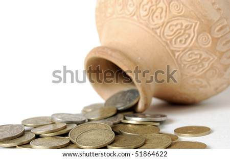 Coins Spilling from a container - stock photo