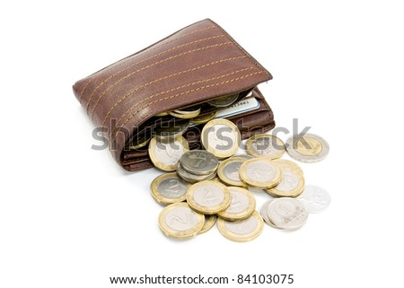 coins spilling out of open leather wallet - stock photo