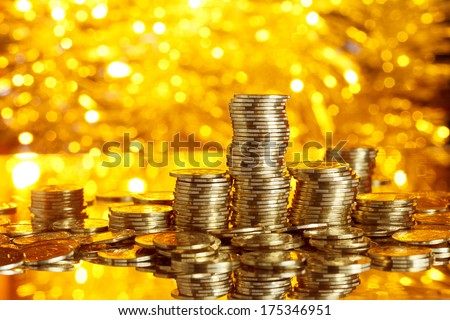 Coins stack on golden bokeh background - stock photo