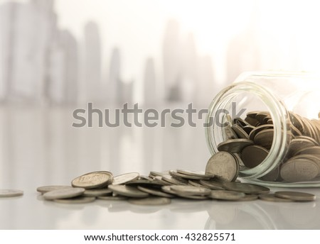 Coins stack with city in background. Savings, Finance and Banking, Business Growth Concept. - stock photo