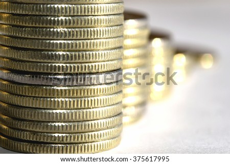Coins stacked in bars. The concept of revenue growth - stock photo