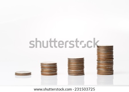 coins stacking up in graph shape on white background