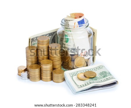 Coins stacks and jar full of coins and paper currency isolated on white background - stock photo