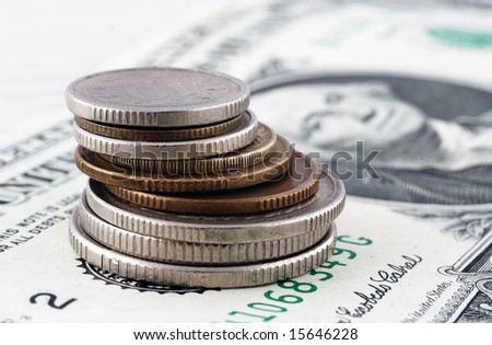 Coins stacks close-up over dollar background