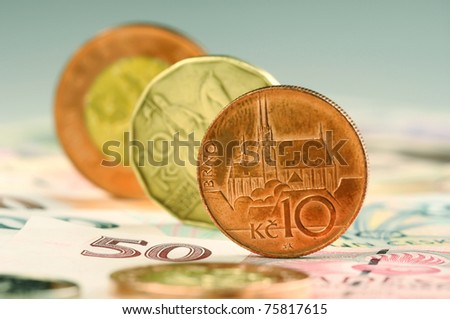 Coins standing on their edges of amount ten, twenty and fifty - stock photo