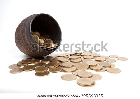 coins thai baht in Earthen jar on white background - stock photo
