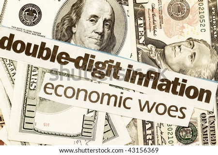 Coins US dollar bills with newspaper headlines on economic difficulty concept. - stock photo