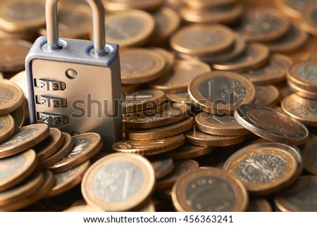 coins with lock - stock photo