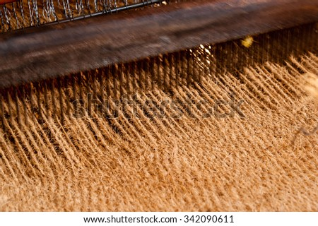 Coir matting being woven on a hand  operated coir loom at a co-operative in south India. - stock photo