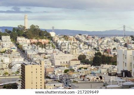 Coit Tower, aka the Lillian Coit Memorial Tower on Telegraph Hill neighborhood of San Francisco, California, United States of America. A view of the flutted white tower from Lombard street. - stock photo