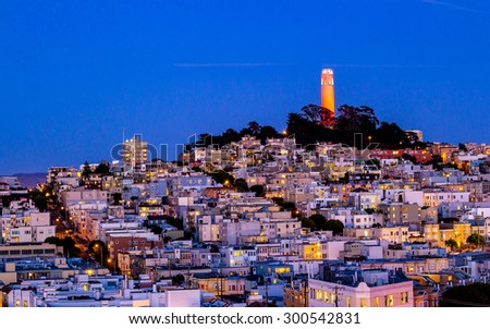 Coit tower and houses on the hill san francisco at night - stock photo