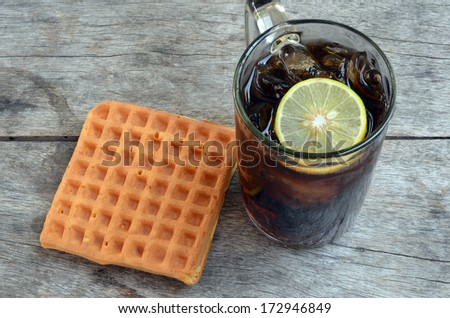 Coke with lemon and Sweet waffles - stock photo