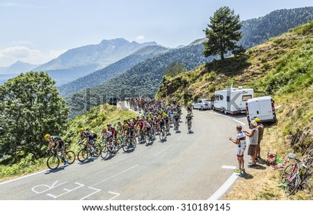 COL D'ASPIN,FRANCE - JUL 15: The peloton climbing the road to Col D'Aspin  in Pyrenees Mountains during the stage 11 of Le Tour de France on Juy 15, 2015. - stock photo
