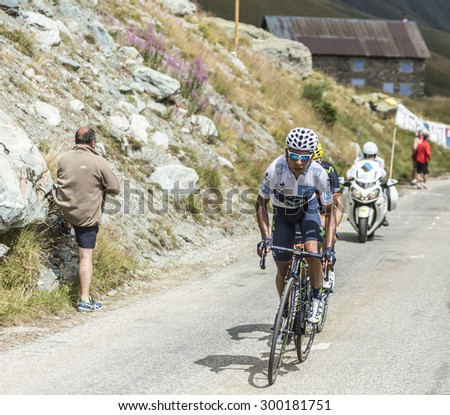 COL DE LA CROIX DE FER, FRANCE - JULY 25: Nairo Quintana in White Jersey climbing to the Col de la Croix de Fer in Alps during the stage 20 of Le Tour de France on July 25, 2015.  - stock photo