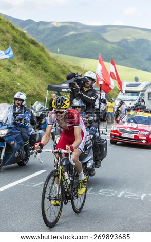 COL DE PEYRESOURDE,FRANCE-JUL 23:Rein Taaramae (Team  Cofidis) climbing the road to Col de Peyresourde in Pyrenees Mountains during the stage 17 of Le Tour de France on 23 July 2014. - stock photo