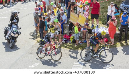 COL DU GLANDON, FRANCE - JUL 23: Alejandro Valverde of Movistar Team and Bauke Mollema of Trek Team riding on the road to Col du Glandon in Alps during the stage 18 of Le Tour de France 2015. - stock photo