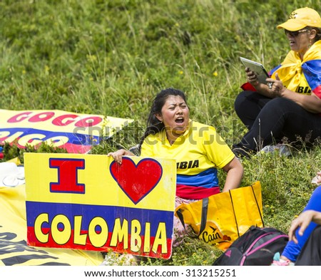 COL DU GLANDON, FRANCE - JUL 24: Colombian supporters cheering their favourites on the road to Col du Glandon in Alps, during the stage 19 of Le Tour de France on July 24, 2015. - stock photo