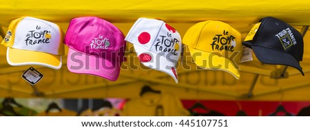 COL DU GLANDON, FRANCE - JUL 23: Image of promotional caps of Le Tour de France hanging at an Official Shop located on Col du Glandon in Alps during the stage 18 of Le Tour de France on July 23, 2015.