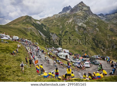 COL DU GLANDON, FRANCE - JUL 24: The peloton riding in a beautiful curve at Col du Glandon in Alps during the stage 19 of Le Tour de France on July 24, 2015. - stock photo