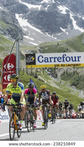 COL DU LAUTARET,FRANCE - JUL 19:Group of cyclists,Nicolas Roche, Jose Serpa, Christophe Riblon,arrived first on mountain pass Lautaret during the stage 14 of Le Tour de France on July 19 2014. - stock photo