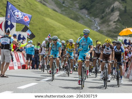 COL DU LAUTARET,FRANCE - JUL 19: Team Astana with Vincenzo Nibali wearing the Yellow Jersey arrives on mountain pass Lautaret during the stage 14 of Le Tour de France on July 19 2014.  - stock photo