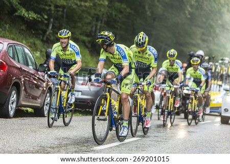 COL DU PLATZERWASEL, FRANCE - JUL 14: Members of the Team Thinkoff - Saxo help Contador after he crashed to climb to Col du Platzerwasel, during the stage 10 of Le Tour de France on July 14 2014. - stock photo