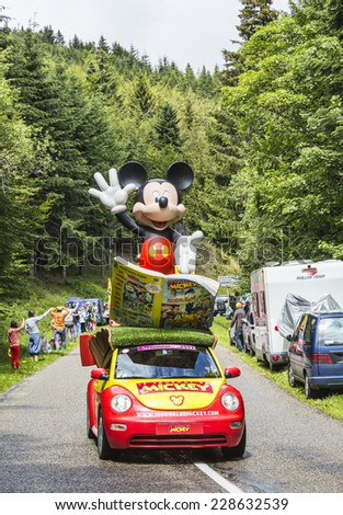 COL DU PLATZERWASEL,FRANCE - JUL 14: Mickey Mouse's car during the passing of the publicity caravan on the road to Mountain Pass Platzerwasel, during Le Tour de France on July 14 2014 - stock photo