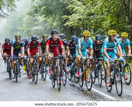 COL DU PLATZERWASEL,FRANCE - JUL 14: Nibali and Porte  ride inside the peloton while climbing the road to mountain pass Platzerwasel in Vosges Mountains, during Le Tour de France on July 14 2014 - stock photo