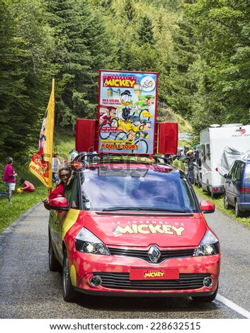 "COL DU PLATZERWASEL,FRANCE - JUL 14:The car of ""Le Journal du Mickey"" during the passing of the publicity caravan on the road to Mountain Pass Platzerwasel, during Le Tour de France on July 14 2014 - stock photo"