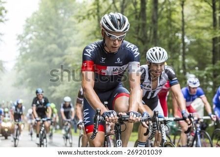 COL DU PLATZERWASEL, FRANCE - JUL 14:The cyclist Sebastien Reichenbach of IAM Cycling Team, climbing the mountain pass Platzerwasel during the stage 10 of Le Tour de France on July 14 2014 - stock photo