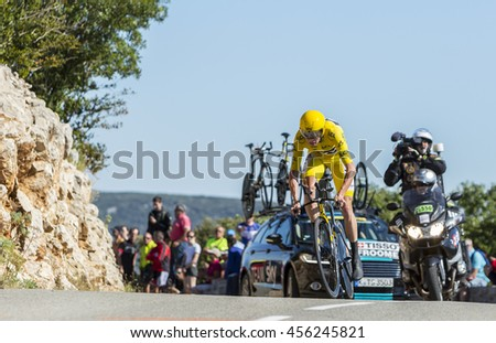 COL DU SERRE DE TOURRE, FRANCE - JUL 15: The cyclist Christopher Froome of Team Sky, in Yellow Jersey, riding jn an individual time trial stage on Col du Serre de Tourre during Tour de France 2016