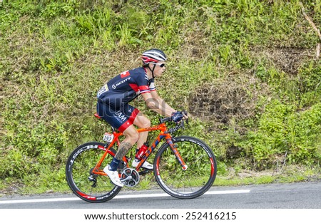 COL DU TOURMALET, FRANCE - JUL 24:The French cyclist Sylvain Chavanel (IAM CyclingTeam) climbing the difficult road to Col de Tourmalet in the stage 18 of Le Tour de France on July 24, 2014. - stock photo
