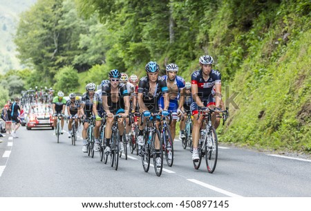 COL DU TOURMALET, FRANCE - JUL 24:  The peloton climbing the road to Col de Tourmalet in the stage 18 of Le Tour de France on July 24, 2014.