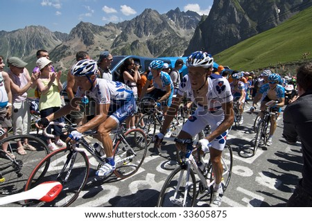 COL DU TOURMALET, FRANCE - JULY 12: A group of riders climb the final kilometer of the Col du Tourmalet in Stage 9 of the 2009 Tour de France on July 12, 2009 in France.