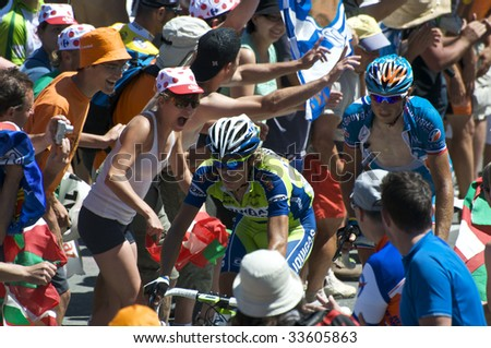 COL DU TOURMALET, FRANCE - JULY 12: Two of the leaders climb the Col du Tourmalet in Stage 9 of the 2009 Tour de France on July 12, 2009 in France. - stock photo