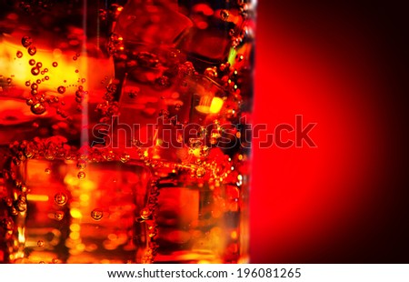 Cola background. Cola with Ice and bubbles in glass closeup. Food background - stock photo