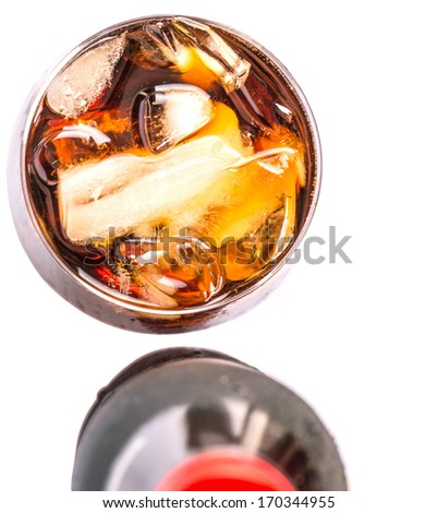 Cola drink in a bottle and short glass with ice cubes over white background