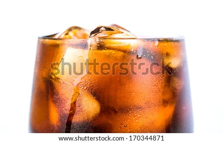 Cola drink with ice cubes in a short glass over white background - stock photo