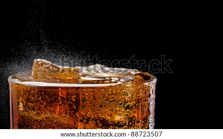 Cola glass with ice, closeup, fizzing, fizz - stock photo