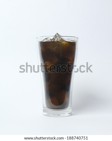 Cola glass with ice cubes isolated on white background. - stock photo