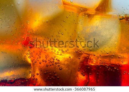 Cola ice cubes bubbles macro close up - stock photo