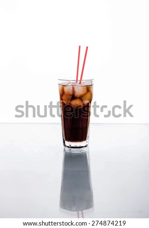 Cola in a glass with ice with red tube. soft drinks - stock photo