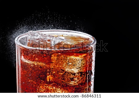 Cola in glass with ice, black background, isolated - stock photo