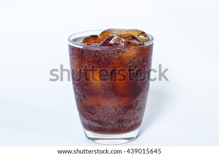 Cola in glass with ice on white background
