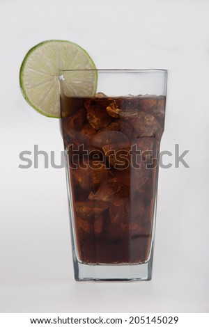 Cola in glass with lemon slice. Isolated on white background - stock photo