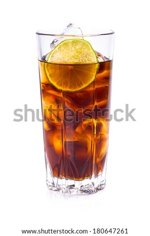 Cola in tall glass with ice cubes and lime over white  - stock photo