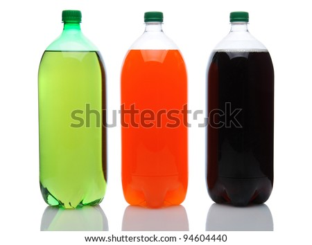 Cola, Lemon Lime and Orange two liter soda bottles on a white background with reflection. - stock photo