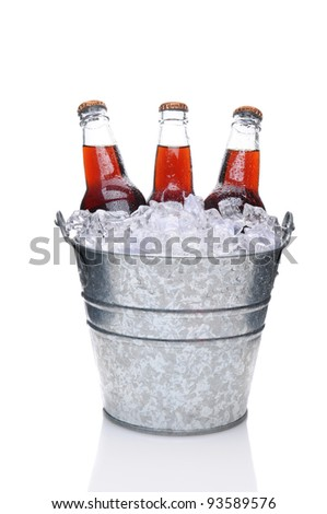 Cola Soda Bottles in a Bucket Filled with ice. Vertical Format over a white background with reflection. - stock photo