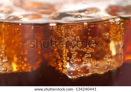 cola with ice cubes close up. - stock photo