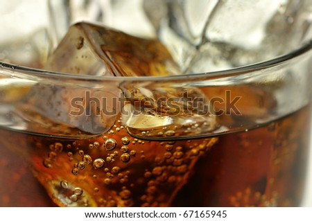 cola with ice cubes close up - stock photo